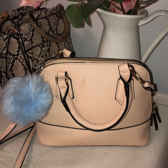 Pink purse with puff ball